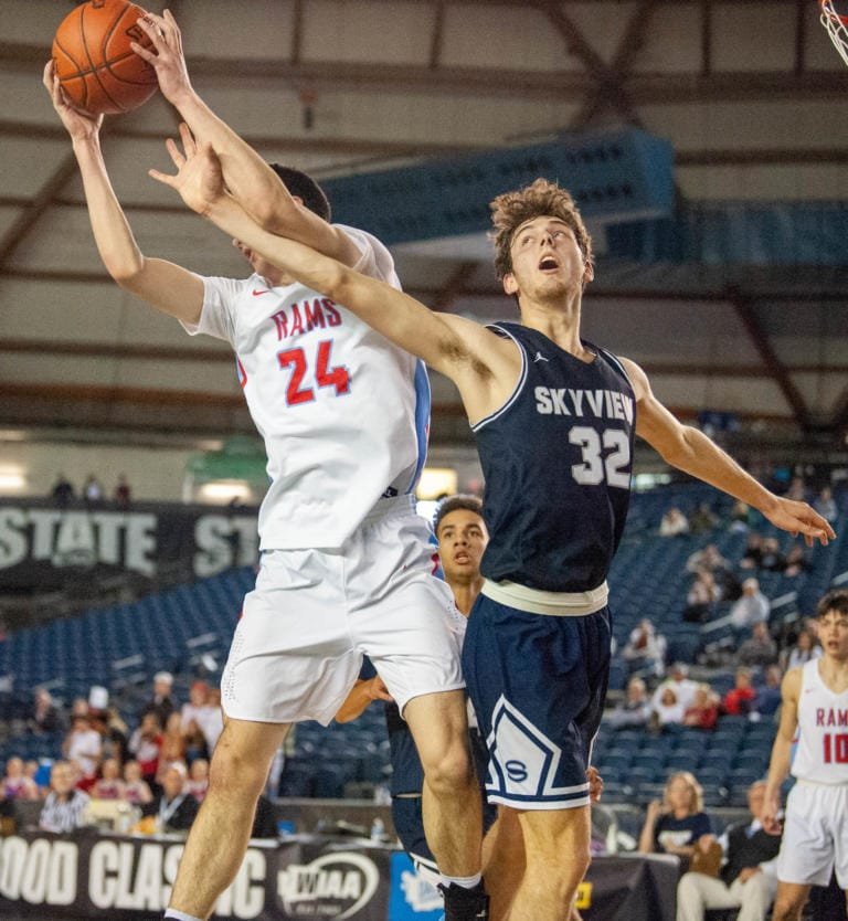 Skyview's Cody McKinney and West Valley's Logan Kinloch fight for a rebound in a 4A State round-of-12 game Wednesday at the Tacoma Dome.