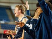 Skyview's Cole Bain, left, celebrates a Jace Chatman 3-pointer with his teammates on the bench during Skyviews' 47-31 victory over West Valley of Yakima in a 4A round-of-12 game Wednesday at the Tacoma Dome.