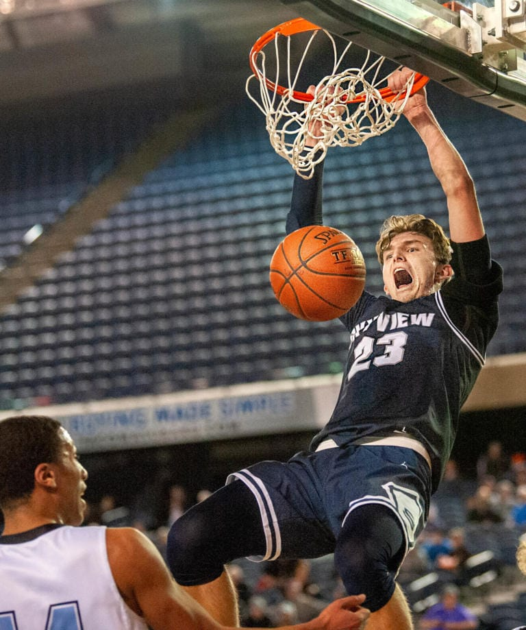 Skyview's Kyle Gruhler slams home a dunk in a 4A State quarterfinal on Thursday at the Tacoma Dome.  The Storm lost 65-64. (Joshua Hart/The Columbian)