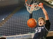 Skyview's Kyle Gruhler slams home a dunk in a 4A State quarterfinal on Thursday at the Tacoma Dome.  The Storm lost 65-64.