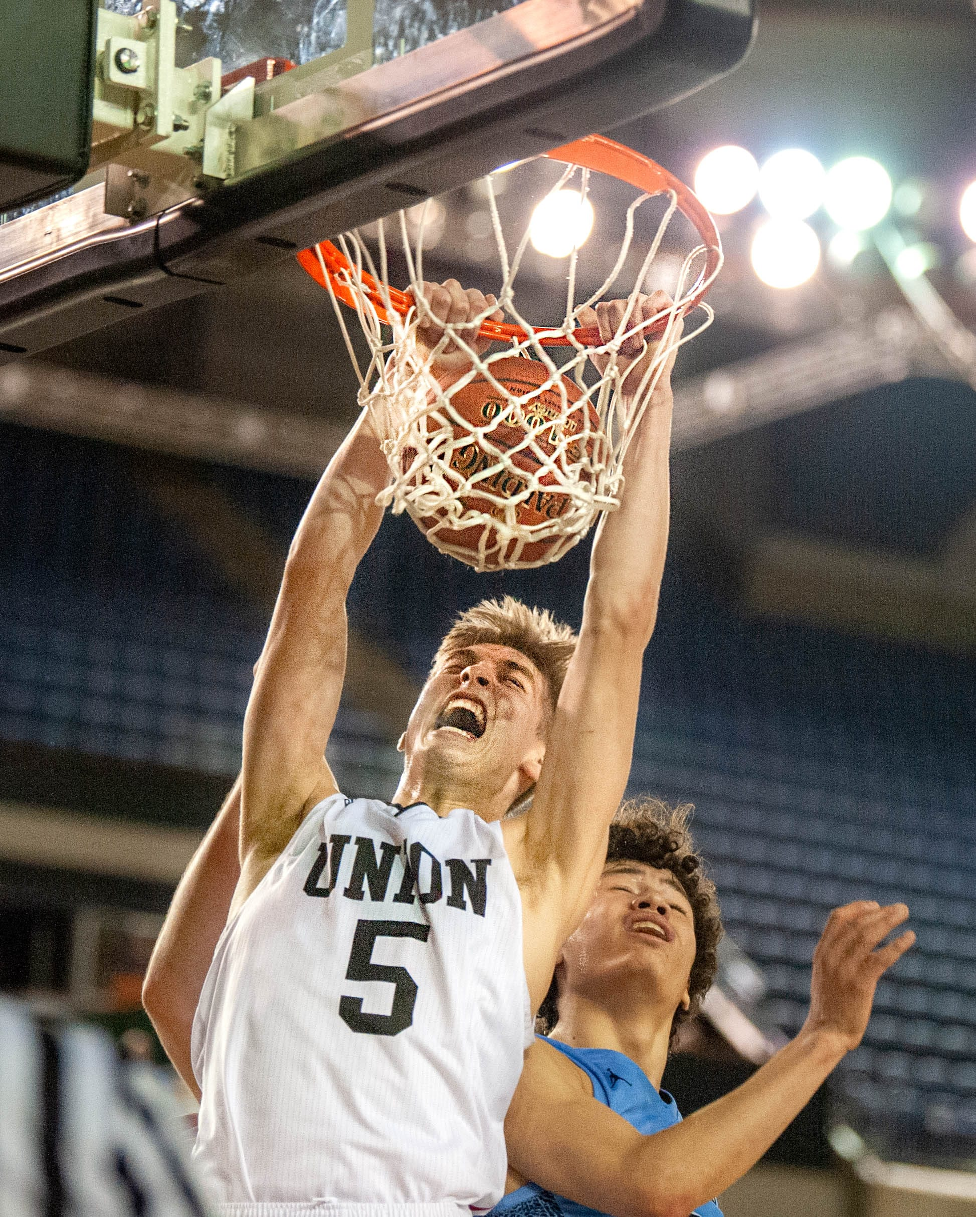 Union's Tanner Toolson dunks the ball late in the fourth quarter of a 4A State semifinal game on Friday at the Tacoma Dome. Union lost 63-55. (Joshua Hart/The Columbian)