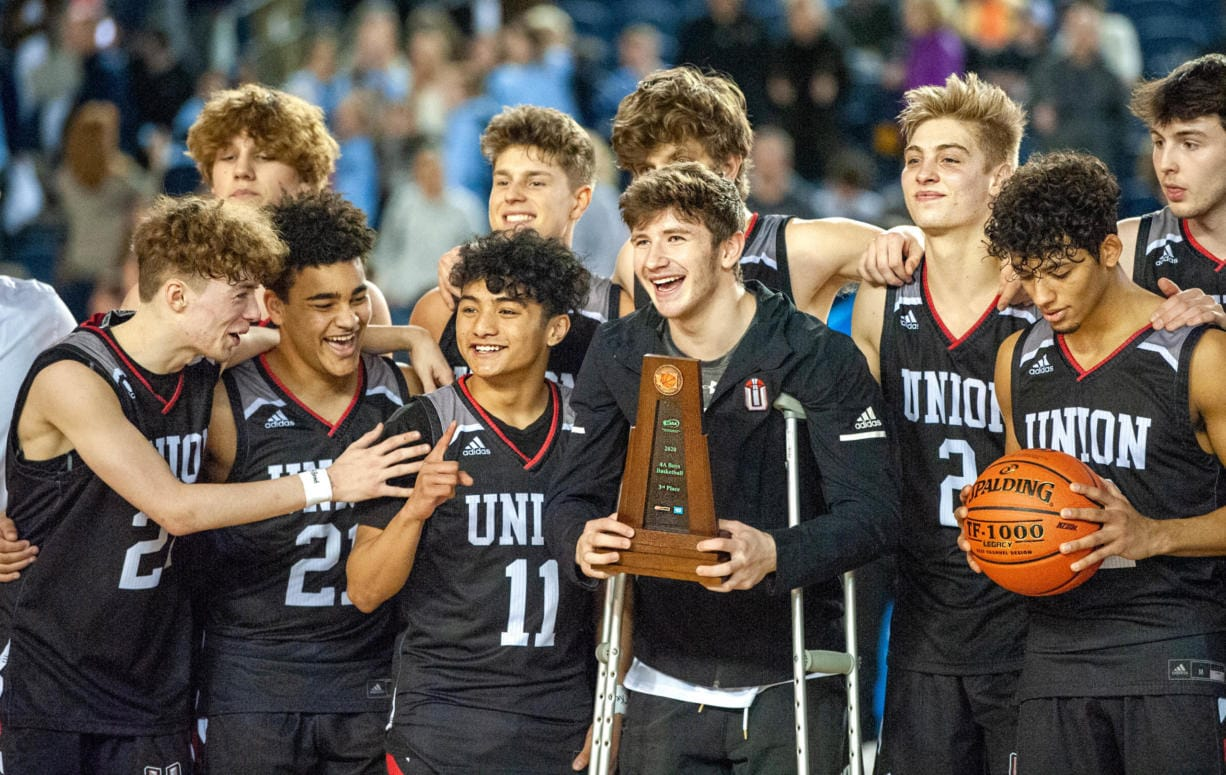 Union players, from left to right (front row) Kaden Horn, Jamison Limbrick, Izaiah Vongnath, Tanner Toolson and Ariya Briscoe celebrate their third-place trophy on Saturday at the Tacoma Dome.