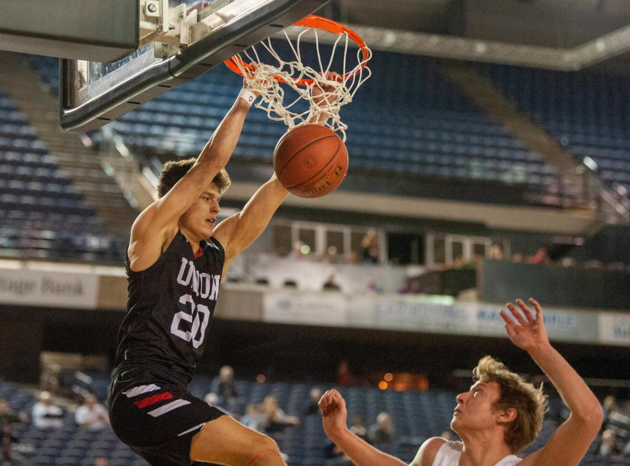 Union's Josh Reznick finishes his dunk in a 4A State trophy game Saturday at the Tacoma Dome. Union finished third.