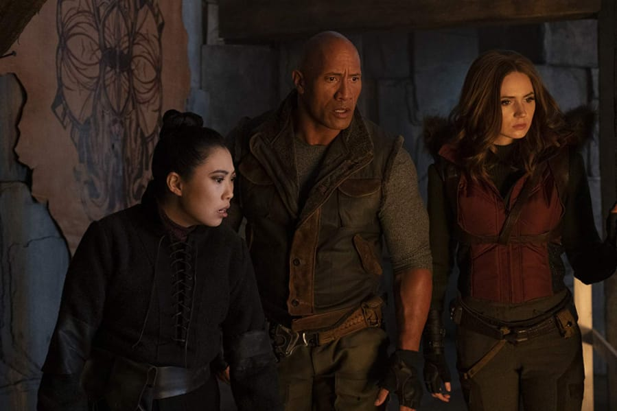 "Awkwafina, from left, Dwayne Johnson, and Karen Gillan in ""Jumanji: The Next Level."" (Frank Masi/Sony Pictures)"