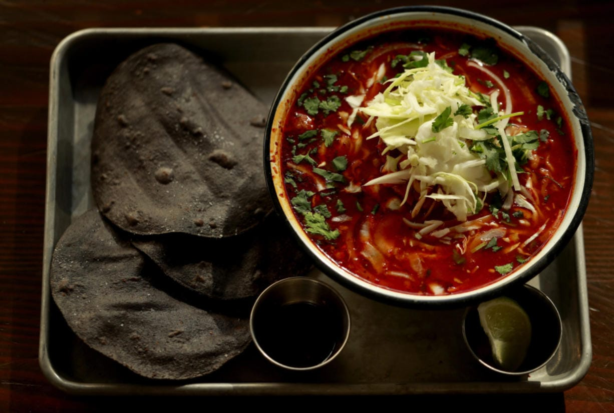 Chef Monica Dimas' recipe for the rich, spicy posole she serves at her Seattle restaurant Little Neon Taco makes a ton - plenty to eat now and also freeze for more comfort later.