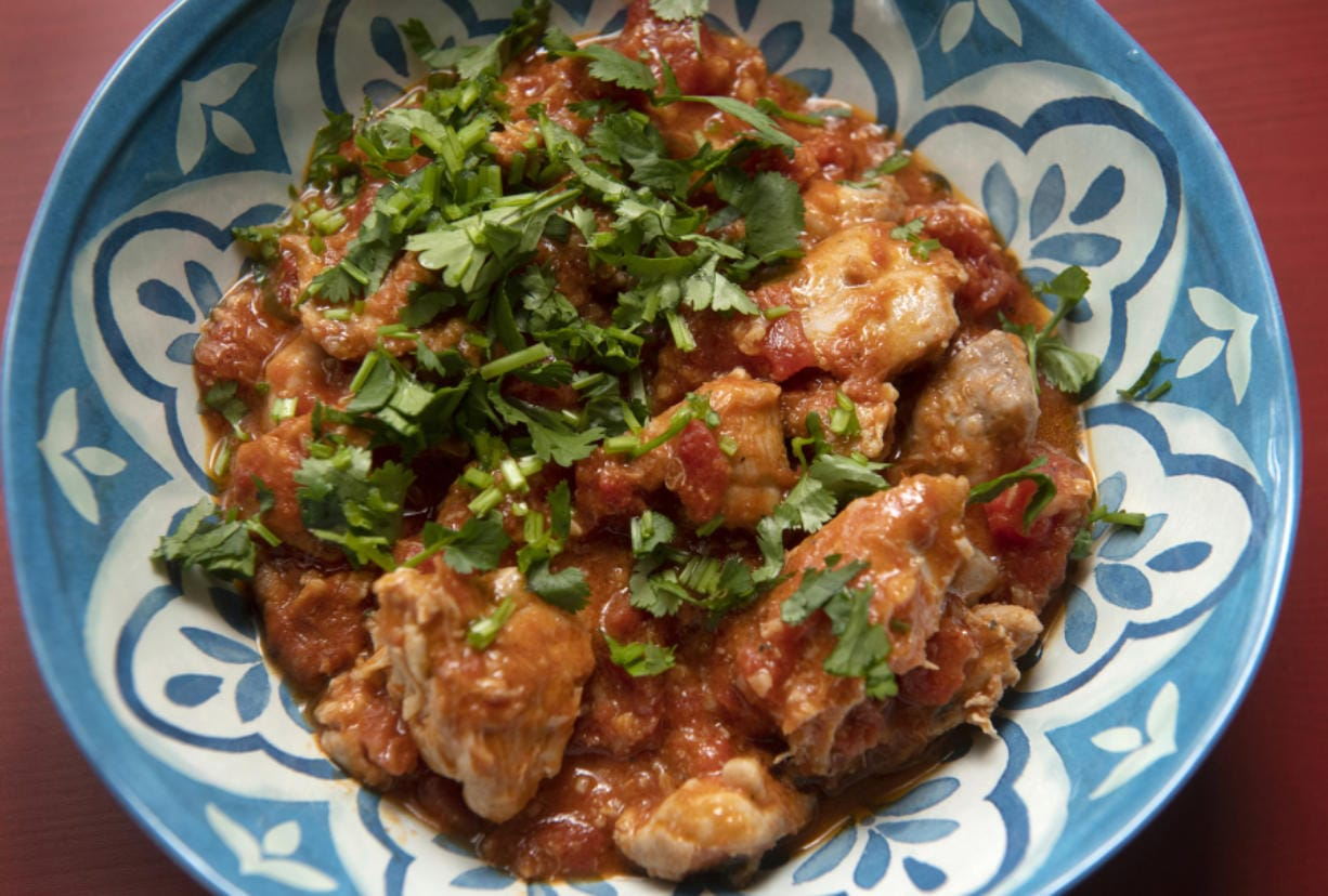 Kenyan coconut chicken is made with tomatoes and coconut milk and flavored with ginger, garlic and ground coriander. (Nate Guidry/Post-Gazette/TNS)