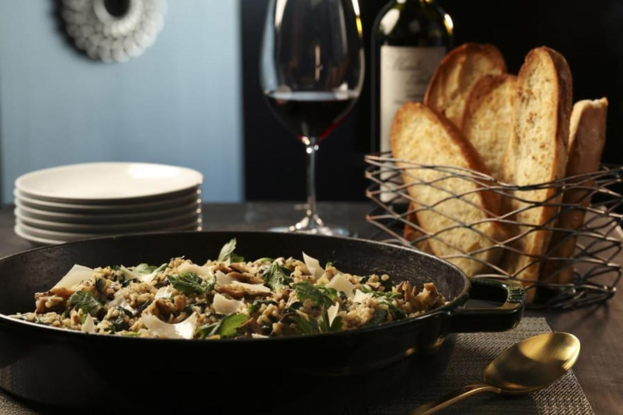 Mushroom risotto, paired with an arugula-grape salad and crusty bread, is a delicious way to use up stockpiles of pantry treasures. Styled by Shannon Kinsella.