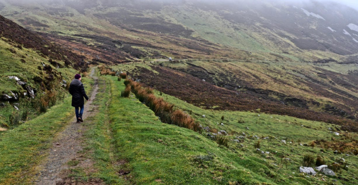 The writer's wife, Mary Carpenter, walks along the Pilgrims Path near Teelin in County Donegal. The West Coast of Ireland is best explored on foot.