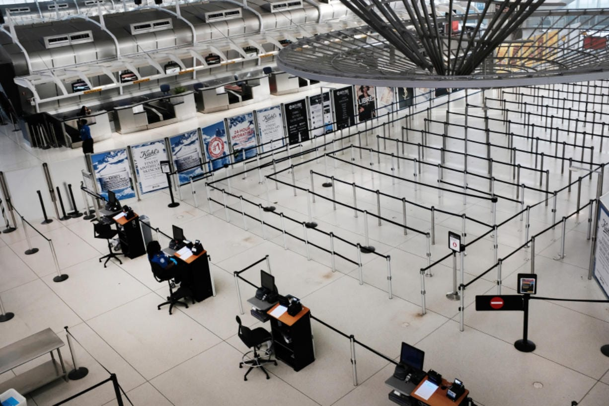 People walk through a sparse international departure terminal at John F. Kennedy Airport as concern over the coronavirus grows on March 7 in New York City, N.Y. (Spencer Platt/Getty Images)