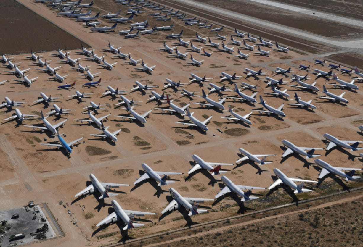 "Planes from various airlines sit in storage at a ""boneyard"" facility March 28, 2019, beside the Southern California Logistics Airport in Victorville, Calif."