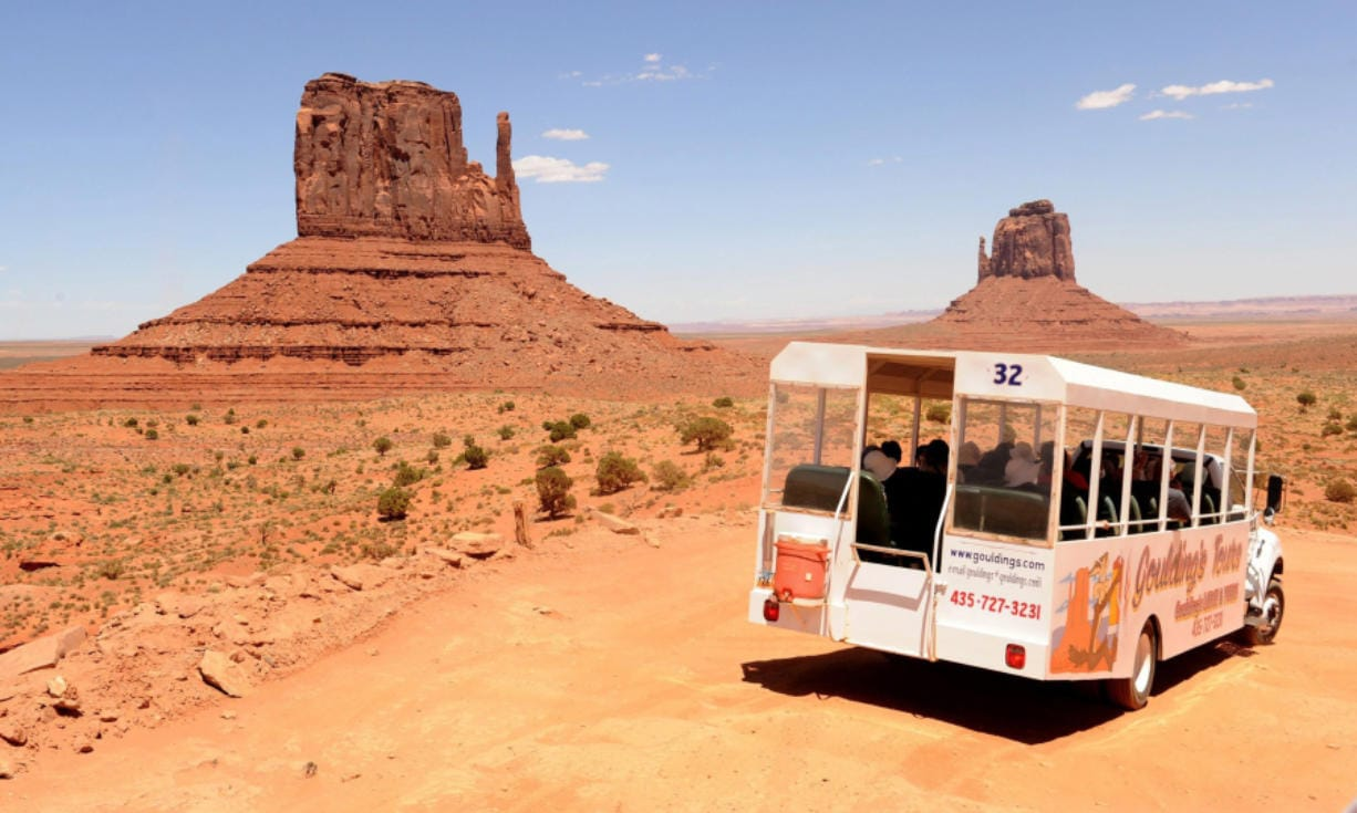A tourist bus stops for a view of Monument Valley on the Utah/Arizona border.