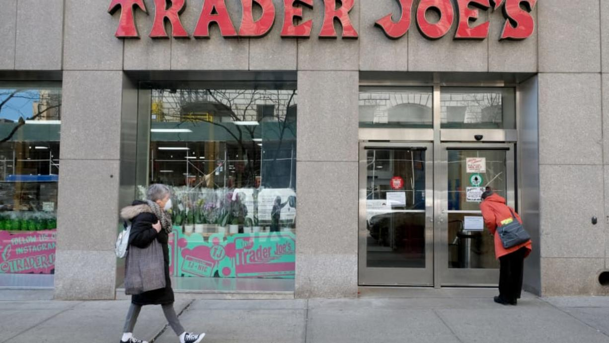 The Trader Joe's store on 14th Street near Union Square in New York is seen March 24 with its doors closed after an employee tested positive for COVID19. A sign outside the store informed customers the store was temporarily closed for cleaning. (Luiz C.