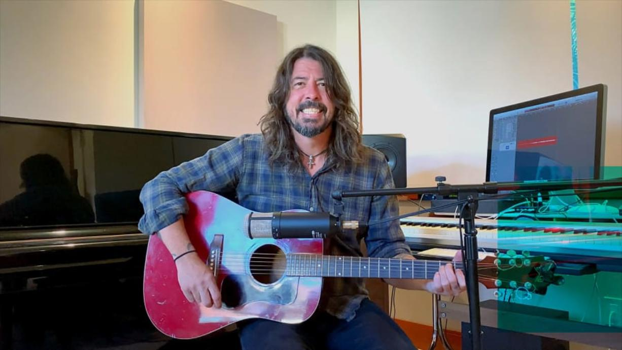 """Dave Grohl performs during the """"Fox Presents the iHeart Living Room Concet for America,"""" a music event to provide entertainment relief and support for Americans to help fight the spread of the COVID-19 virus."""