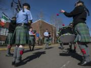 Members of the Fort Vancouver Pipe Band gather outside Hough Elementary School before the Paddy Hough Parade in 2019.