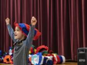 Henry Boge reacts to receiving a Dr. Seuss hat during Read Across America Day at Chinook Elementary School on Monday morning.