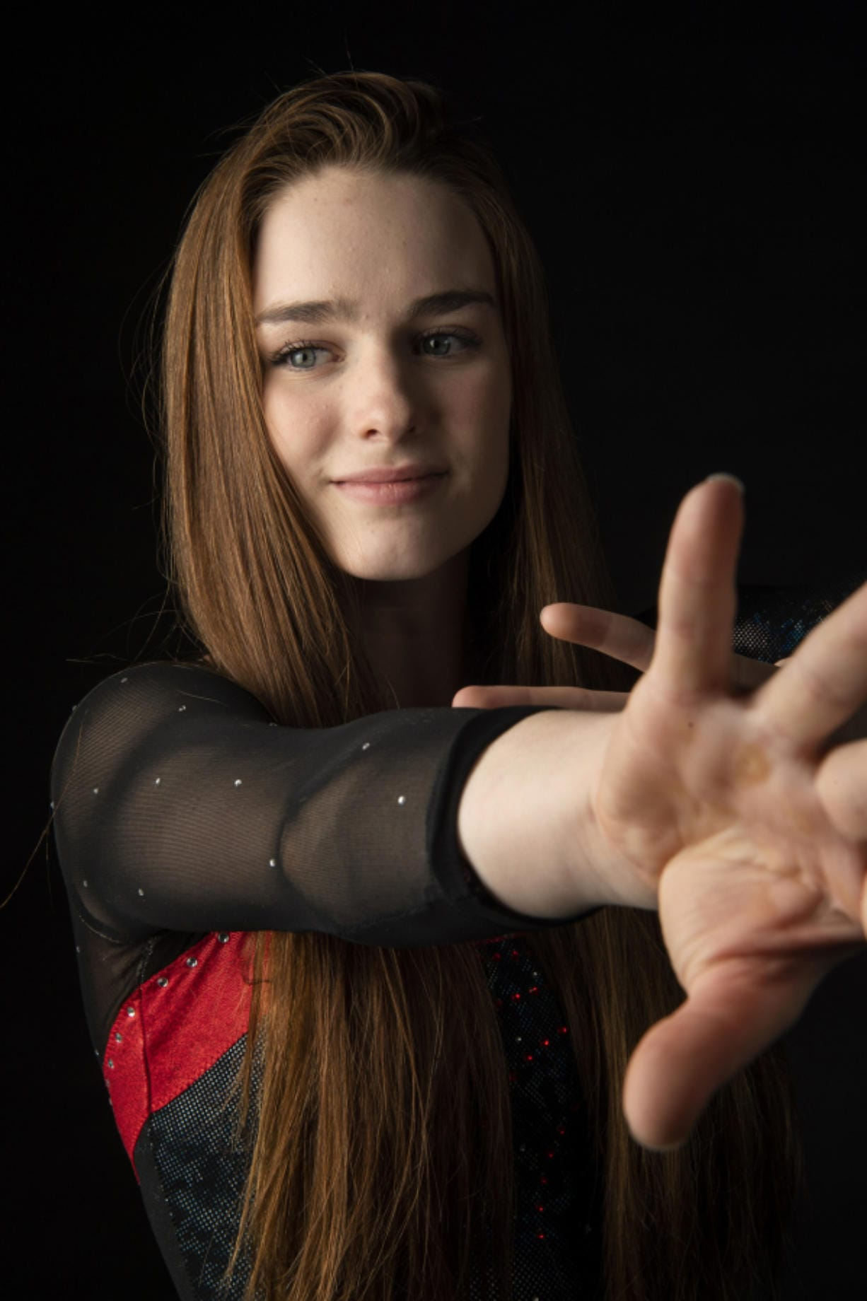 All-Region gymnast Shea McGee of Camas also competes in diving during the fall and in the pole vault in spring to help her gymnastics skills in the winter season.