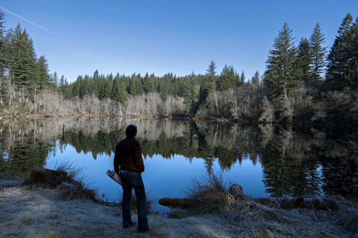 Cherie Kearney, forest conservation director for Columbia Land Trust, looks over Kwoneesum Lake on Tuesday morning. The M.J. Murdock Charitable Trust will provide $450,000 for the Columbia Land Trust to purchase 1,300 acres in Skamania County along Wildboy Creek, a tributary to the West Fork Washougal River. The property, which is currently owned by Weyerhaeuser Co., includes a 45-foot-high dam that the Cowlitz Indian Tribe intends to remove.