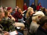The public listens to citizen testimony on the Heights District Plan on Monday at Vancouver City Hall. It was a packed room, with many residents of neighborhoods surrounding the Heights District attending to share their thoughts on the development proposal.