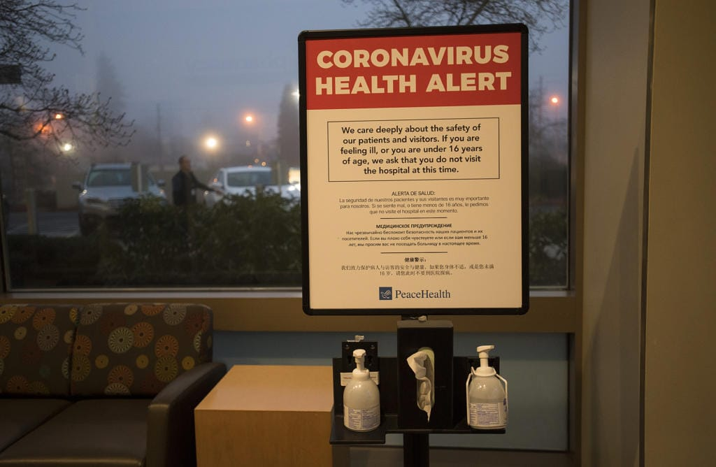 A coronavirus health alert sign is posted at one of the entrances to the Firstenburg Tower on Monday morning at PeaceHealth Southwest Medical Center.