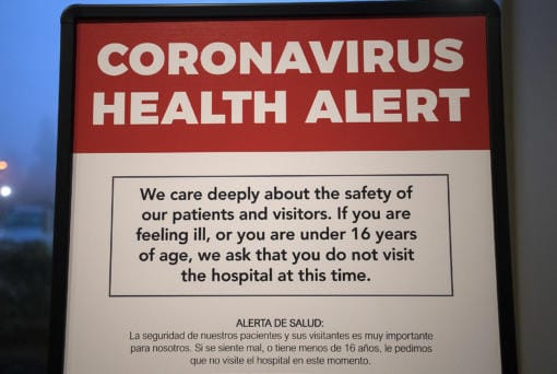 A coronavirus health alert sign is posted at one of the entrances to the Firstenburg Tower at PeaceHealth Southwest Medical Center on Monday morning, March 9, 2020. PeaceHealth has since gone to a no visitor policy.