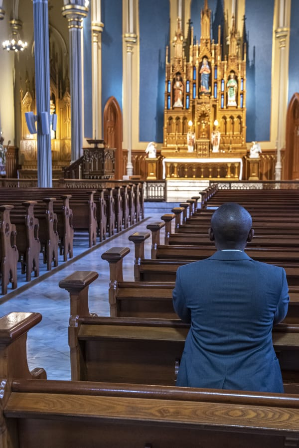 Javier KM prays in the mostly empty nave of The Proto-Cathedral of St. James the Greater in downtown Vancouver.
