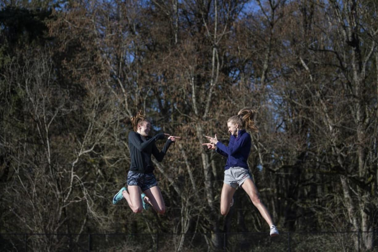 High jumpers Jerrica Pachl, left, and Ellie Saunders, are good friends and teammates at Seton Catholic. They also finished first and second at state last year. (Photos by Alisha Jucevic/The Columbian)