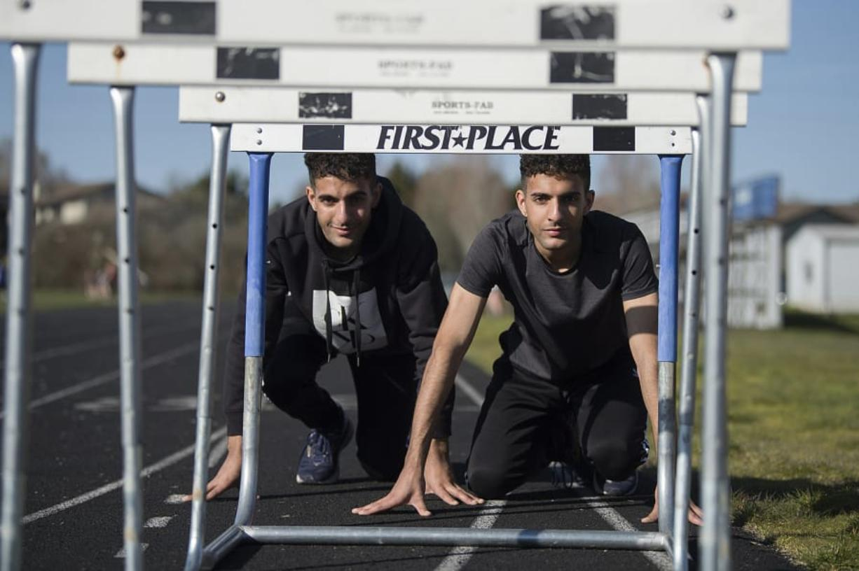 """Mountain View senior David McAndie, right, says of his twin brother James: """"We don't run against each other, we run with each other. A win for one is a win for both."""" (Amanda Cowan/The Columbian)"""