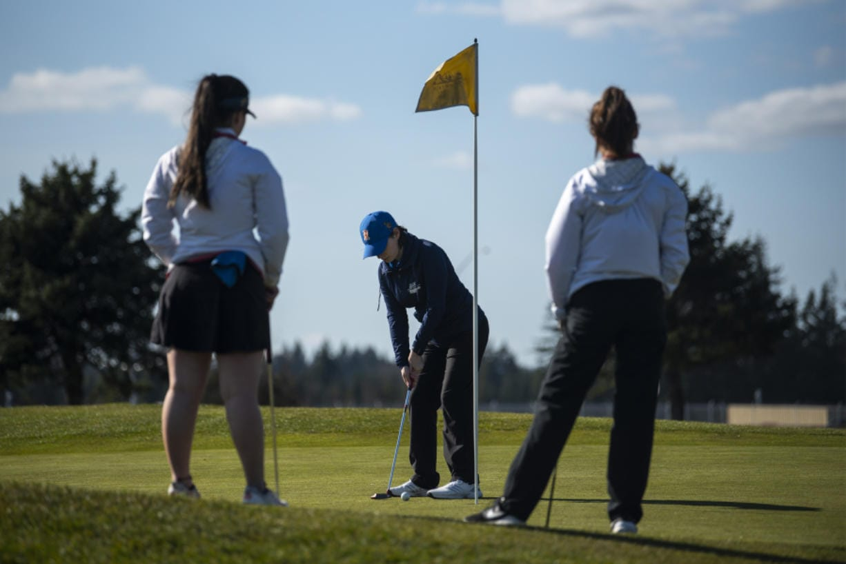Ridgefield golfer Samantha Fenton putts during a match against Union at Tri Mountain Golf Course on Thursday.