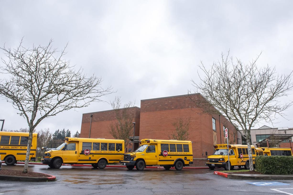 Buses line up to transport students from Covington Middle School on March 13, 2020.