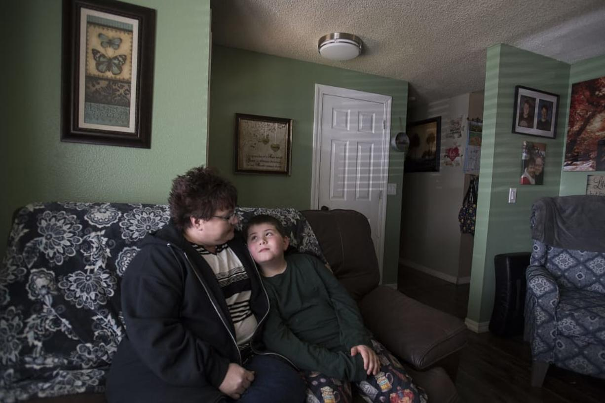 Melissa Dodge, with her son, 9-year-old Lucas, co-founded a support group for mothers of children with autism. The family is among the thousands around the county affected by closures due to the coronavirus pandemic. Lucas, who has autism, is struggling to adjust to the changes.