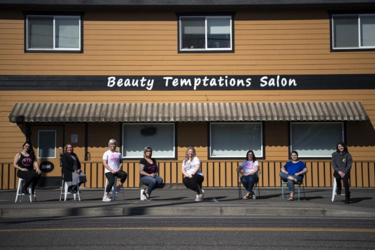 The Beauty Temptations Salon cosmetologists are pictured in Washougal on Thursday. The women had to shutter the salon Tuesday after the COVID-19 outbreak forced closures of salons across the state, effectively putting eight self-employed cosmetologists out of business.