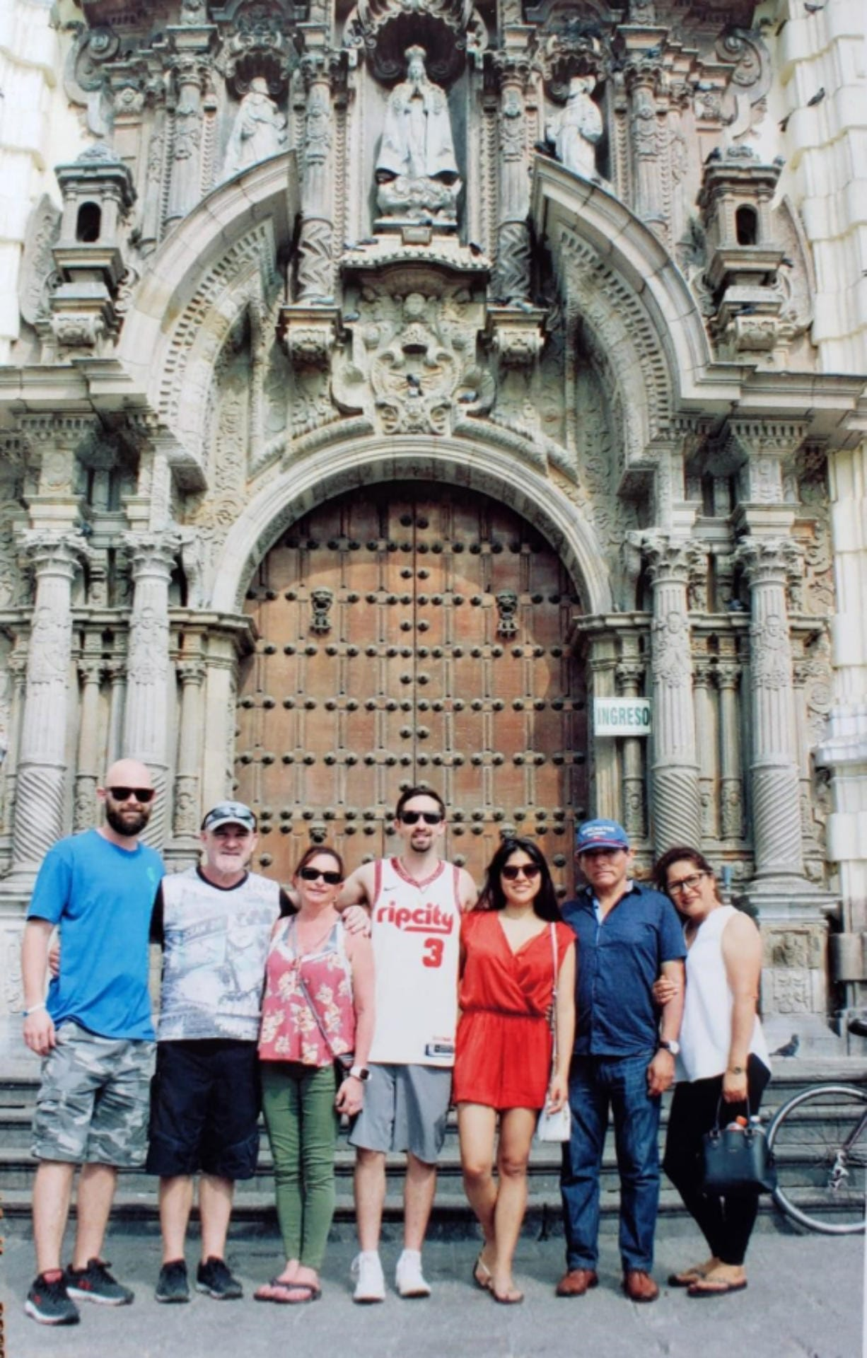 Heidi Marshall, third from left, poses with her family in front of the St. Francis Monastery in Lima, Peru. Marshall and four others are stuck near Lima after arriving on March 13 to visit her new in-laws.