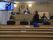 Judge Gregory Gonzales presides over a nearly empty courtroom while joined by attorney Jeff Sowder during first appearances in Clark County Superior Court on Tuesday morning. Gonzales was able to see and talk to the defendants through live video from the jail, a precaution being employed due to the COVID-19 pandemic.