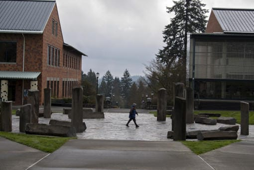 A lone pedestrian strolls through an empty campus at Washington State University Vancouver in late March.