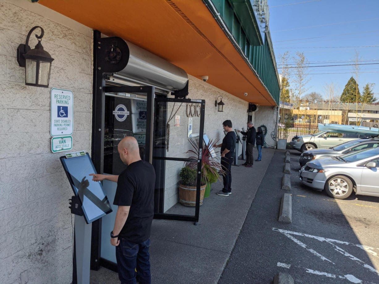 New Vansterdam and other cannabis shops are still operating but have implemented increasingly drastic social distancing measures. New Vansterdam moved all of its ordering kiosks outside the building to maintain separation distances. (New Vansterdam)