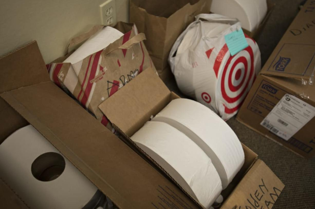 "Oversized rolls of toilet paper are collected at In It Together RN in downtown Vancouver before being distributed to local adult family homes throughout Clark County.  Adult family homes are beginning to encounter shortages of necessities, such as toilet paper, and personal protective equipment.  ""This is a bigger problem than we realized,"" Beth Paul said."