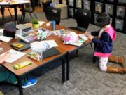 At Camp Evergreen and other child care centers, staff are advised to keep children 6 feet apart while allowing 10 or fewer people in any given classroom.