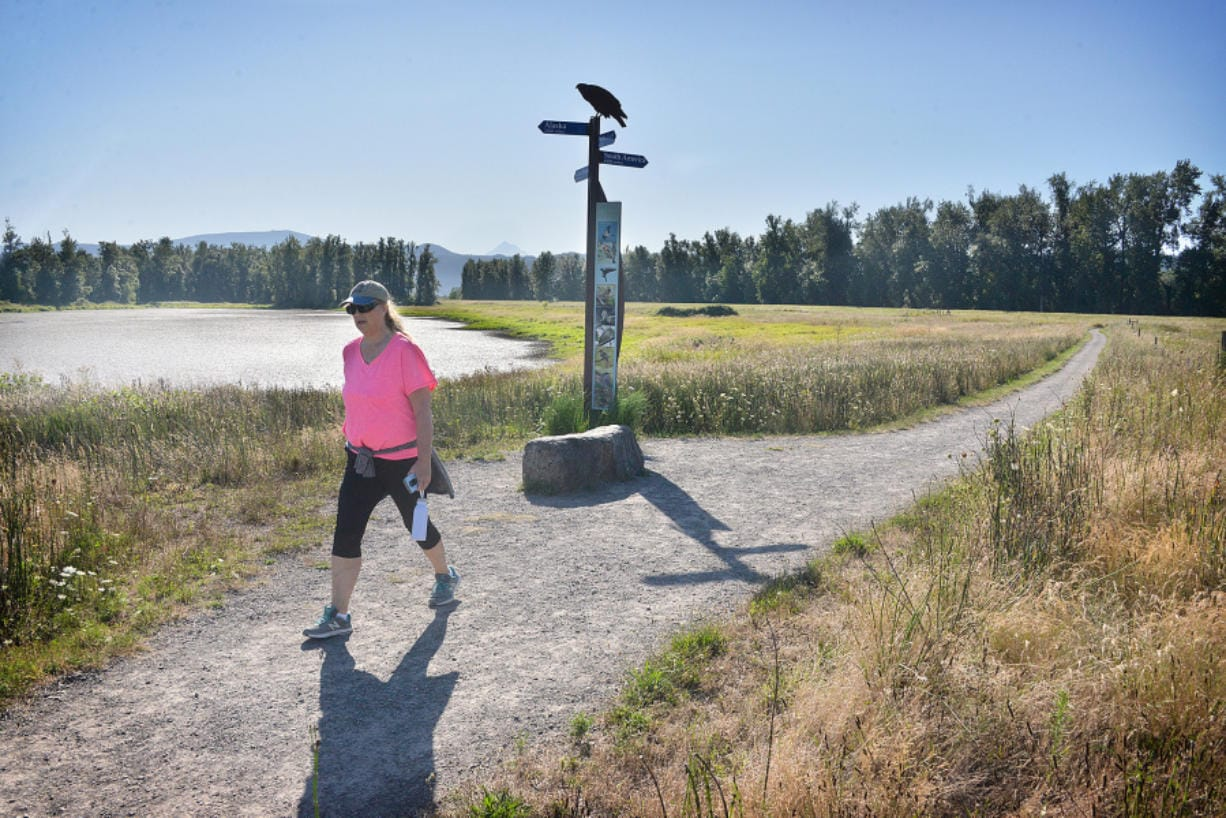 Judy Byron of Washougal takes a morning hike at Steigerwald Lake National Wildlife Refuge in 2019. (The Columbian files)