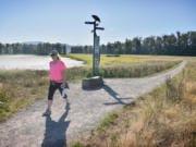 Judy Byron of Washougal takes a morning hike at Steigerwald Lake National Wildlife Refuge in 2019.
