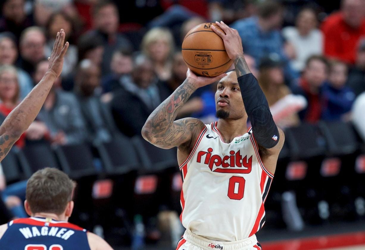 Portland Trail Blazers guard Damian Lillard shoots over Washington Wizards forward Moritz Wagner during the second half of an NBA basketball game in Portland, Ore., Wednesday, March 4, 2020.