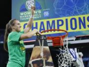 Oregon's Sabrina Ionescu (20) reacts while cutting down the net after defeating Stanford in an NCAA college basketball game in the final of the Pac-12 women's tournament Sunday, March 8, 2020, in Las Vegas.