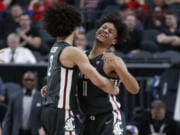 Washington State's CJ Elleby, left, and DJ Rodman celebrate after a play against Colorado during the second half of an NCAA college basketball game in the first round of the Pac-12 men's tournament Wednesday, March 11, 2020, in Las Vegas.