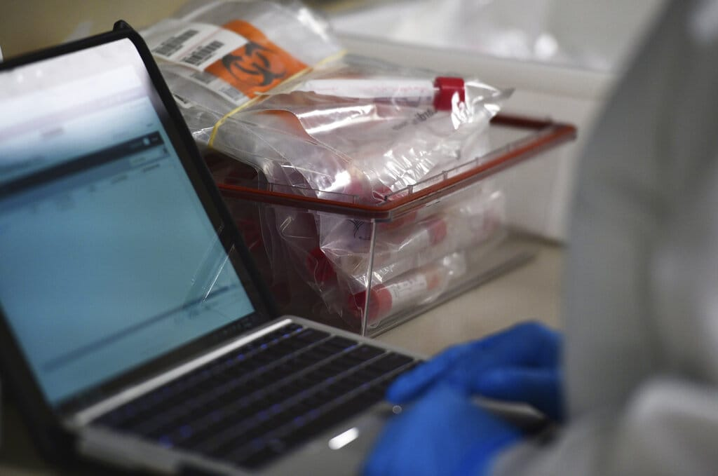 A lab tech tests samples for COVID-19 coronavirus at the Colorado Department of Public Health and Environment Laboratory Services Division in Denver. A company in Vancouver is working to develop a home test for COVID-19.