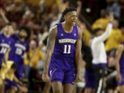 Washington's Nahziah Carter (11) celebrates a3-pointer against Arizona State late in the second half of an NCAA college basketball game Thursday, March 5, 2020, in Tempe, Ariz. Washington won 90-83.