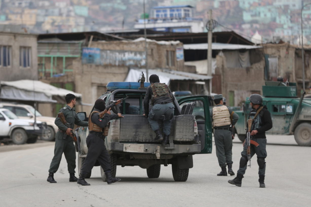 Afghan personnel arrive at the site of an attack in Kabul, Afghanistan, Wednesday, March 25, 2020. Gunmen stormed a religious gathering of Afghanistan's minority Sikhs in their place of worship in the heart of the Afghan capital's old city on Wednesday, a minority Sikh parliamentarian said.