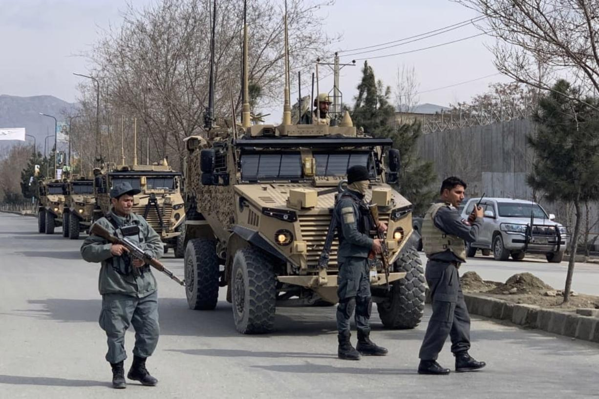 Foreign security personnel and Afghan police arrive at the site of an attack in Kabul, Afghanistan, Friday, March 6, 2020.