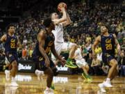 Oregon guard Payton Pritchard (3) shoots against California during the first half during an NCAA college basketball game in Eugene, Ore., Thursday, March 5, 2020.