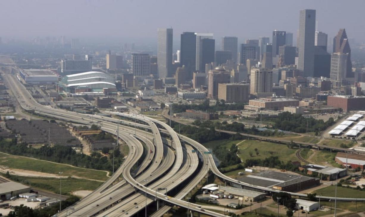 FILE - This Sept. 22, 2005 file photo shows Houston, Texas. Three metro areas in the Lone Star State had some of the biggest population gains over the past decade, according to figures released Thursday, March 26, 2020, by the U.S. Census Bureau. Dallas increased by 1.2 million people, the most of any U.S. metro area, followed by Houston, which added another 1.1 million residents over the decade. Austin grew by more than a half million residents from 2010 to 2019, the eighth biggest numeric growth among U.S. metros, according to the bureau's population estimates.(AP Photo/Pat Sullivan, File) (Associated Press files)