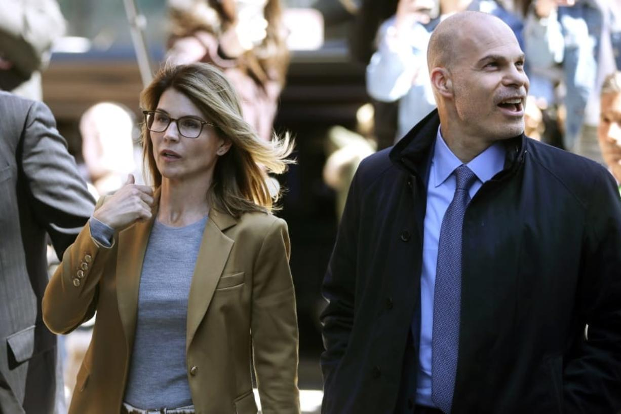 In this April 3, 2019, photo, Lori Loughlin, left, arrives at federal court in Boston with her attorney Sean Berkowitz to face charges in a nationwide college admissions bribery scandal. Berkowitz, a former federal prosecutor, has a reputation for being fearless, yet cool-headed and a master at navigating complex cases.