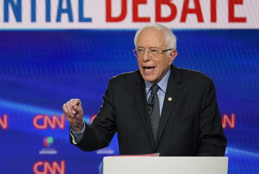 In this Sunday, March 15, 2020, photo, Sen. Bernie Sanders, I-Vt., with former Vice President Joe Biden, speaks during a Democratic presidential primary debate at CNN Studios in Washington. What might be the final showdown between the two very different Democratic candidates takes place Tuesday, March 17, 2020, during Florida's presidential primary.